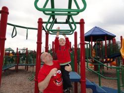 Parent and Child Playing on Playground Equipment