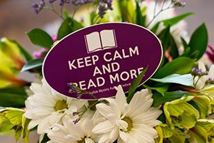 Table Display of Flowers and Sign (Keep Calm and Read More)